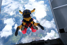 Skydivers Are Jumping Out Of A...