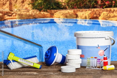 Obraz Equipment with chemical cleaning products and tools for the maintenance of the swimming pool. - fototapety do salonu