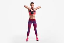 Strong Woman Lifting Kettlebell Up
