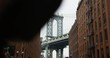 Iconic View of The Infamous Manhattan Bridge People Walking Past The Streets of The Trendy Dumbo Brooklyn
