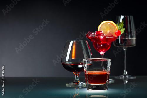 Obraz na plátně  Various alcoholic drinks on a black background.