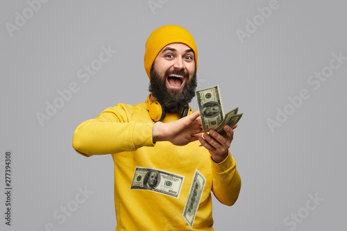 Fotografie, Obraz  Cheerful guy wasting money