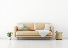 Living Room Interior Wall Mockup With Tan Brown Leather Sofa, Round Green Pillow, Basket, Furry Plaid And Plant In Pot On Empty White Wall Background. 3D Rendering, Illustration.