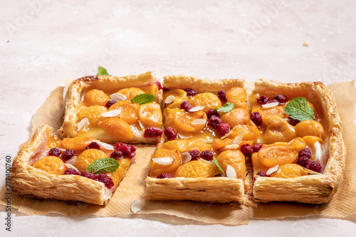 Obraz na płótnie Summer puff pastry tart with apricots and raspberry