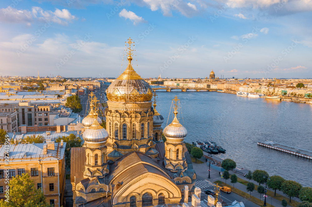 Fototapety, obrazy: Aerial view of the domes of the Assumption Church on the embankment of the Neva River, in the distance Isaaic Cathedral.