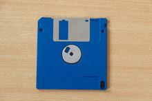 Blue Obsolete Computer Diskette On Wooden Background