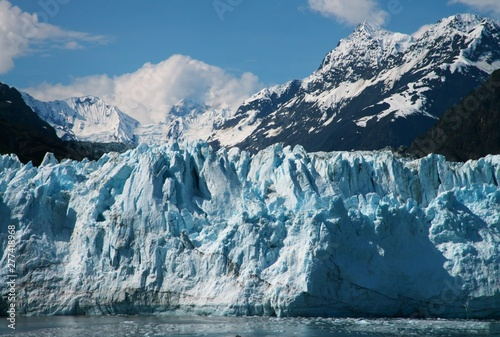 Photo Stands Night blue view of Glacier meeting the Ocean water in Glacier Bay National Park and Preserve
