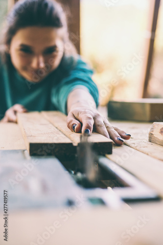 A woman works in a carpentry workshop. Canvas Print