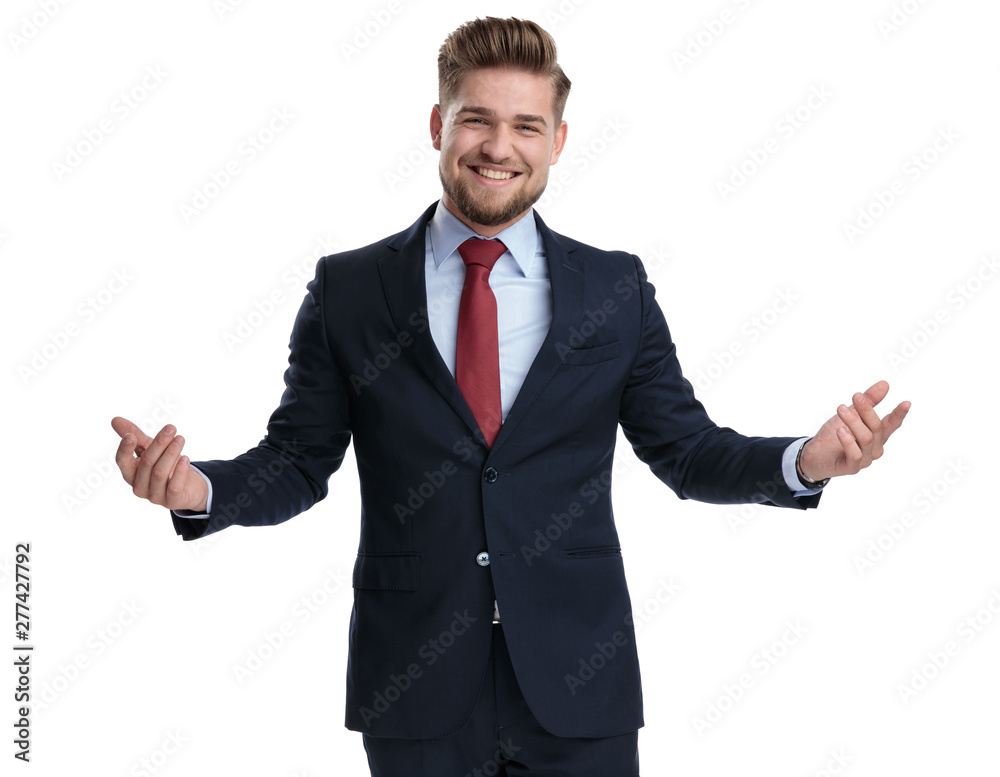Fototapeta Jolly businessman laughing and welcoming with his arms wide open