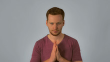 Caucasian Guy With Red Hair Posing Showing Hand Gesture East Greeting Or Thai Greeting Shows Respect Or Reverence By Pressing The Palms And Fingers. Handsome Redhead Men Wearing In Casual T-shirt