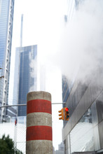 New York City Streets. Factory Pipe With Smoke In New York City, Manhattan.