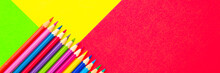 Colorful Background With Many Pencils Crayons Pastels Lined Up On Multi Color Backdrop - Top View Flat Lay