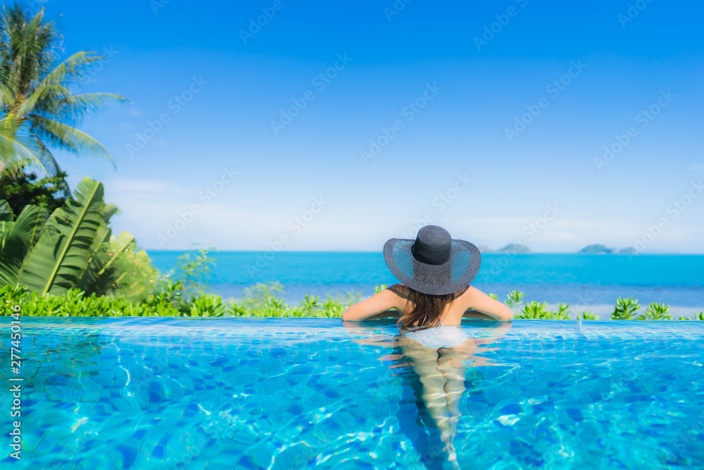 Fototapety, obrazy: Portrait beautiful young asian woman relax in luxury outdoor swimming pool in hotel resort nearly beach sea ocean