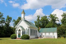 Small Quaint Country Church On A Bright Sunny Day