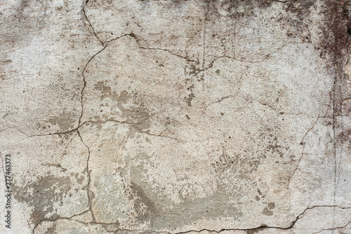 Texture of a concrete wall with cracks and scratches which can be used as a background - 277463373