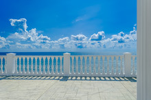 Terrace With White Balusters To Amazing Views Of The Sea, Sky And White Clouds.