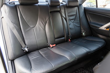 View To The Interior Of Car With Dashboard, Rear Seats, Black Leather After Cleaning Before Sale On Parking