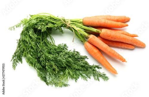 Foto Tasty fresh carrot on white background