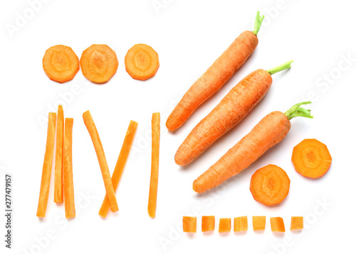 Pieces with carrot on white background Billede på lærred