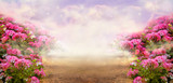Fantasy summer panoramic photo background with rose field and misty path leading to mysterious glow. Idyllic tranquil morning scene and empty copy space. Road goes across hills to fairytale.