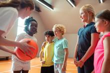 Children Listening To Coach Ex...
