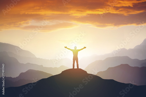 Climber arms up outstretched on mountain top looking at inspirational landscape Fototapet