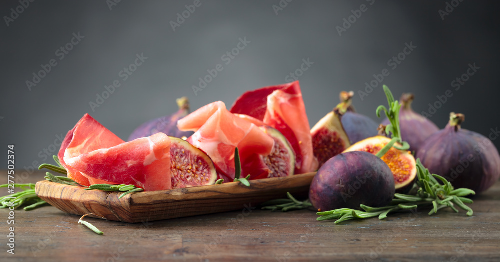 Fototapety, obrazy: Prosciutto with figs and rosemary.