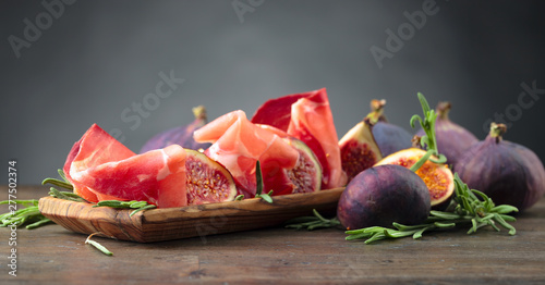 Photo  Prosciutto with figs and rosemary.