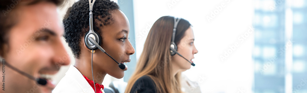 Fototapeta Group of diverse telemarketing team in call center office banner background