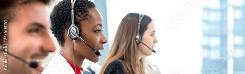 Fototapeta Group of diverse telemarketing team in call center office banner background obraz