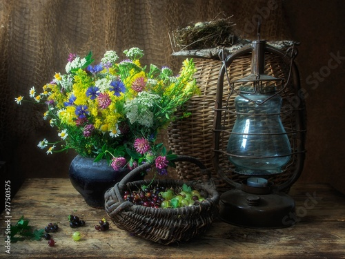Fototapeta Still life with bouquet of wildflowers and berry obraz