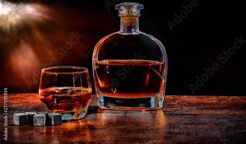 Bottle and glass of brandy with reusable ice cubes Canvas Print