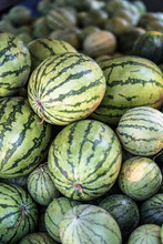 Watermelons And Melons Are Sold On The Market In Asia. Sale Of Vegetarian Fruits Outdoors. Stock Photos
