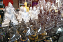 Souvenirs On The Shelves Of The Market In Sri Lanka. Buddha Figurines Sold