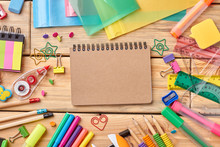 Notebook And School Accessories On Wooden Background. School Supplies On Wooden Table, Top View.