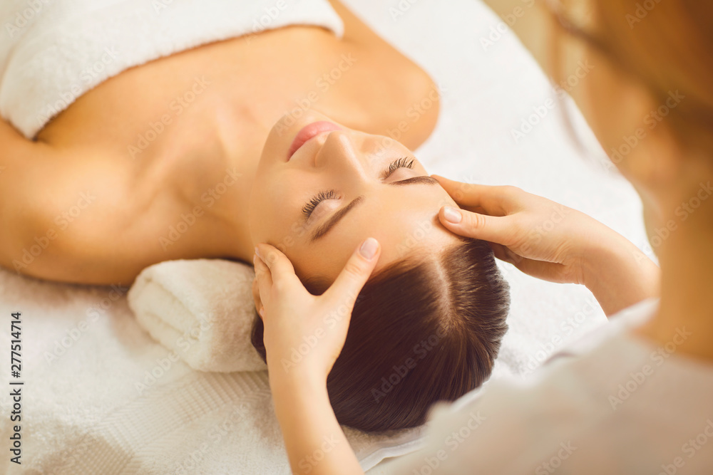 Fototapety, obrazy: Face woman massage close up in a beauty clinic.