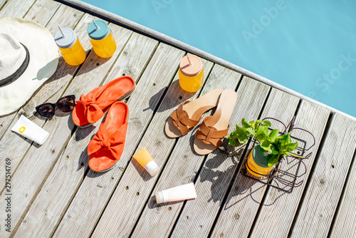 Stampa su Tela View on the poolside with accessories for summer vacations, drinks, slippers, su