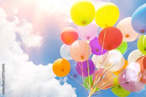 Bunch of colorful balloons on sky background Fotobehang