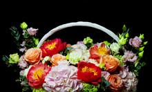 Bright White Flower Arrangement In A Basket On A Dark Background