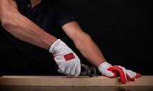 Men's Hands Use Pincers On A Black Background