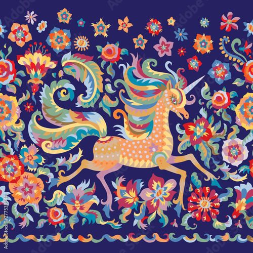 Valokuva Floral seamless border pattern in folklore tapestry tradition, unicorn print on a dark indigo blue background