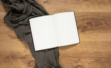 Blank Book With With Empty Pages On A Warm Wooden Background And A Brown Polka Dot Scarf