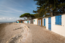 Tiny Colorful Houses Made Of Wood On The Beach