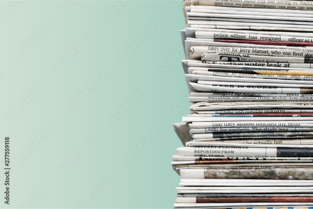 Fototapety, obrazy: Pile of newspapers on background