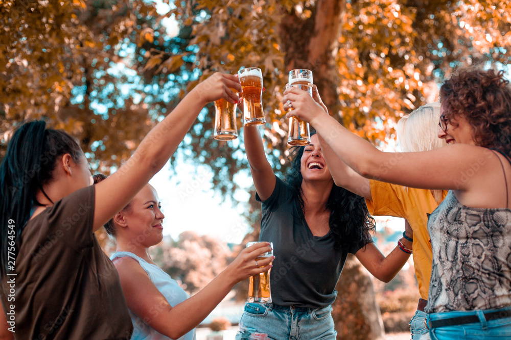 Fototapety, obrazy: Happy group of best female friends drinking beer - Friendship concept with young female friends enjoying time and having genuine fun at outdoor nature ambient