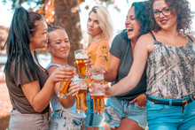Happy Group Of Best Female Friends Drinking Beer - Young Female Friends Enjoying Time And Having Genuine Fun At Outdoor Nature Ambient