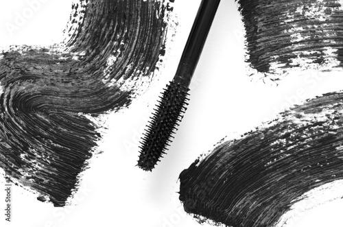 Valokuva  Stroke of black mascara with applicator brush close-up, isolated on white background