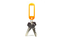 Two Keys And An Orange Label Set On A White Background.