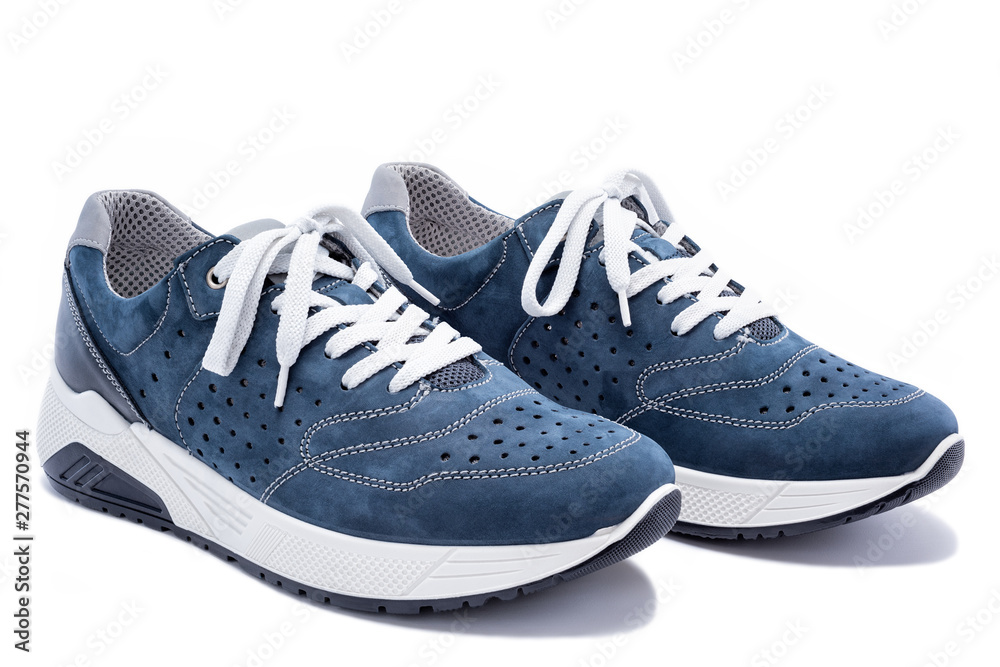 Fototapeta Close up of elegant light blue sports shoes in natural nubuck leather for adult men photographed on a white background. Fashion accessories.
