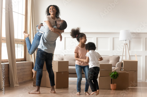 Happy excited african family celebrate moving day relocation together Canvas Print